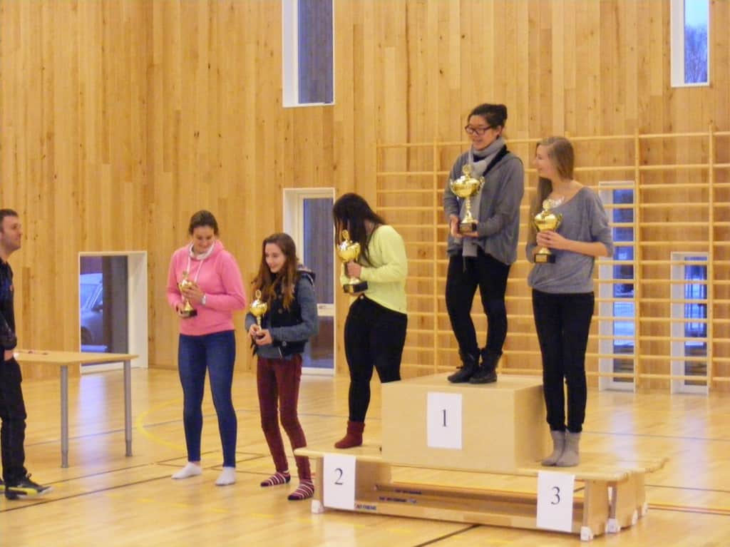 Phoebe (second left) receiving her 4th prize