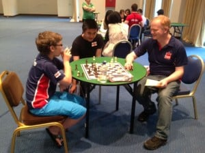 Josh & Yang-Jian with GM Neil McDonald - analysis after round 8