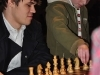 carlsen-and-boy-making-move