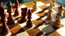 Wooden chess board and pieces
